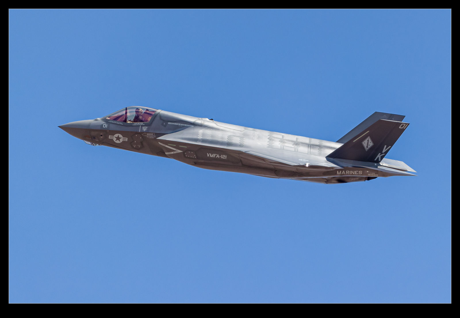 A USMC F-35B climbs out after takeoff from Nellis AFB on a Red Flag mission.