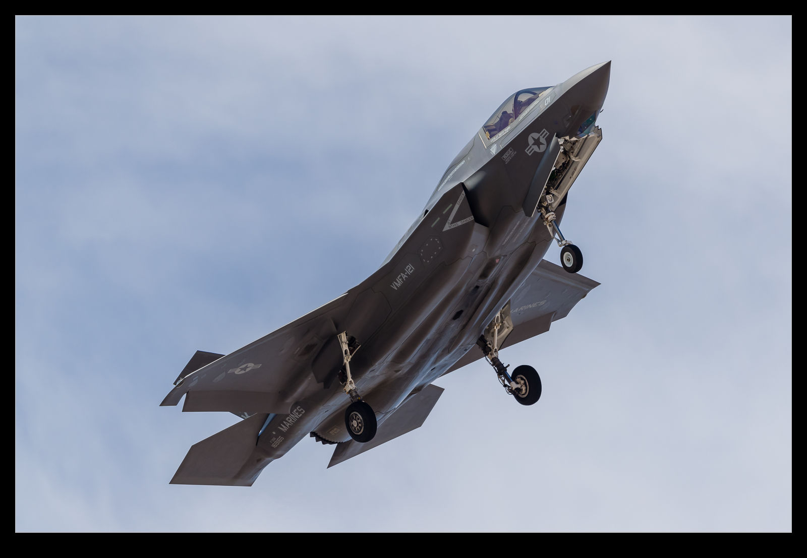 A USMC F-35B turns on to final approach at Nellis AFB.